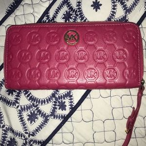 Michael Kors hot pink wallet with strap